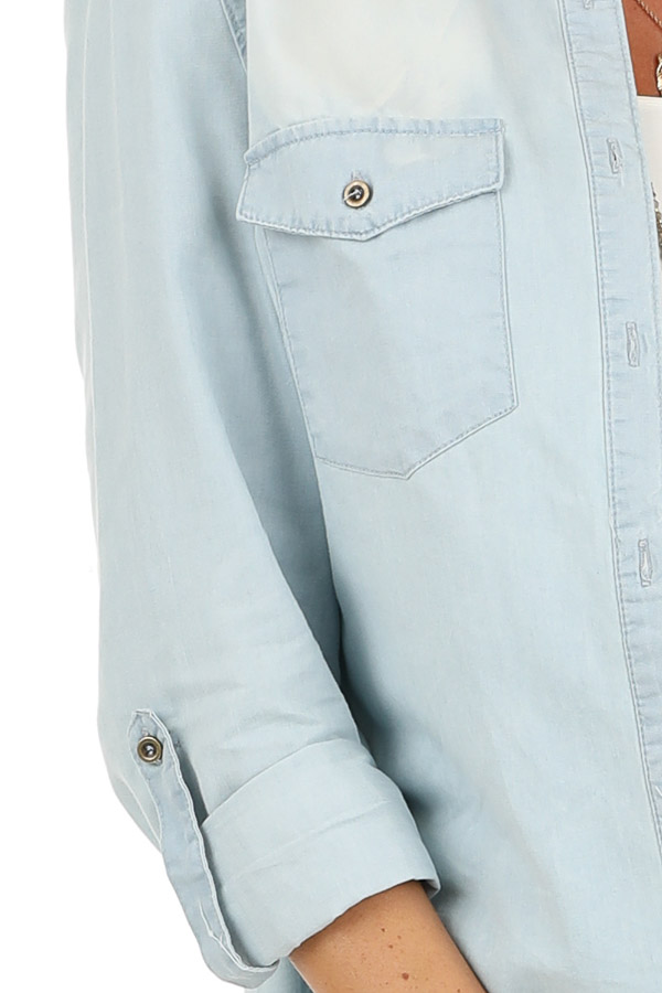 Light Wash Denim Button Up Top with Chest Pockets detail