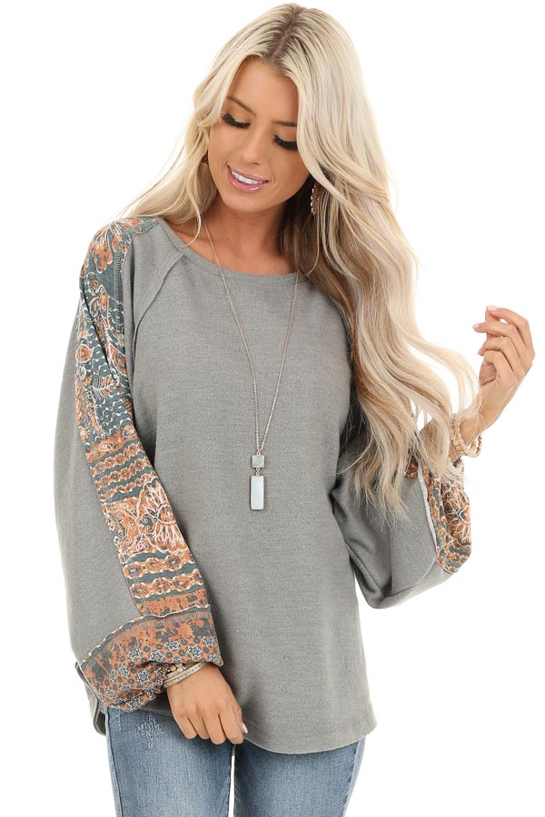 Faded Olive Knit Top with Abstract Detail and Bubble Sleeves front close up