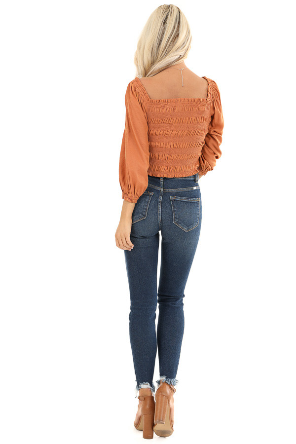 Rust Cropped 3/4 Sleeve Top with Smocked and Cinched Bodice back full body