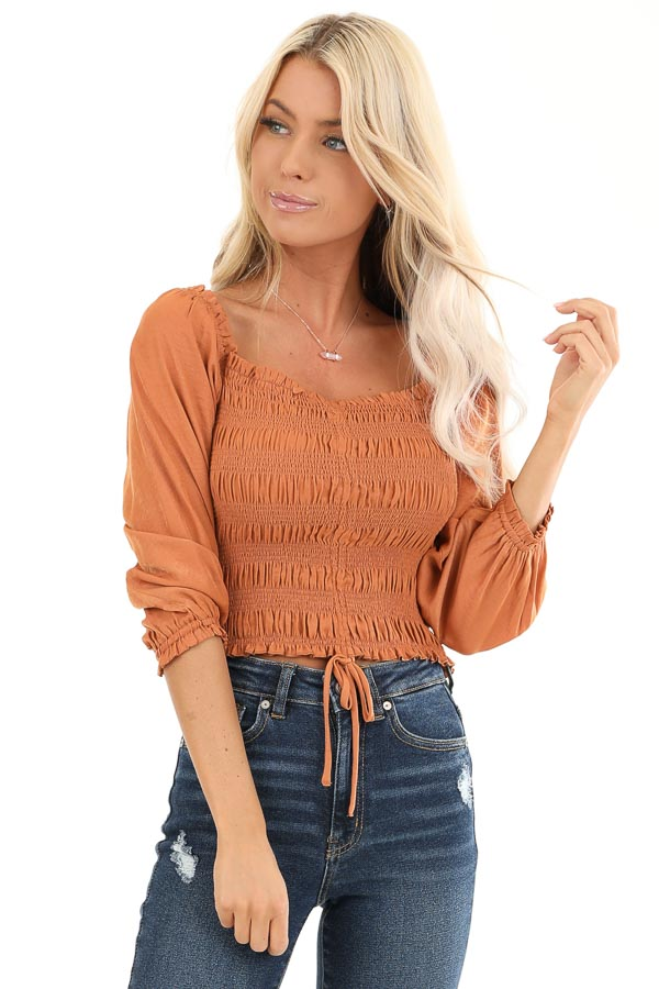 Rust Cropped 3/4 Sleeve Top with Smocked and Cinched Bodice front close up