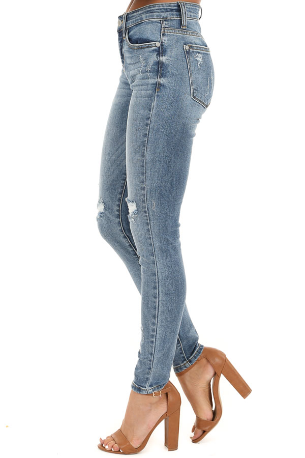 Medium Wash Mid Rise Distressed Skinny Jeans side view