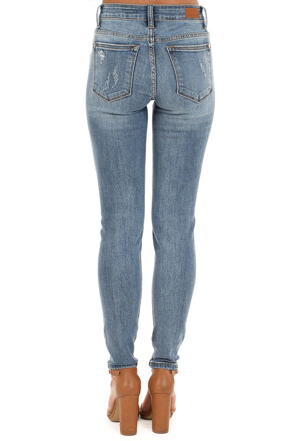 Medium Wash Mid Rise Distressed Skinny Jeans back view