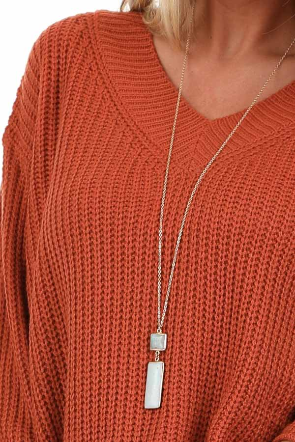 Rust Ribbed Knit Long Sleeve Sweater Top with V Neckline detail
