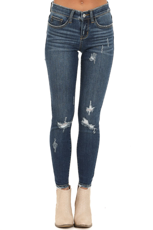 Dark Wash Mid Rise Distressed Skinny Jeans with Frayed Hem front view