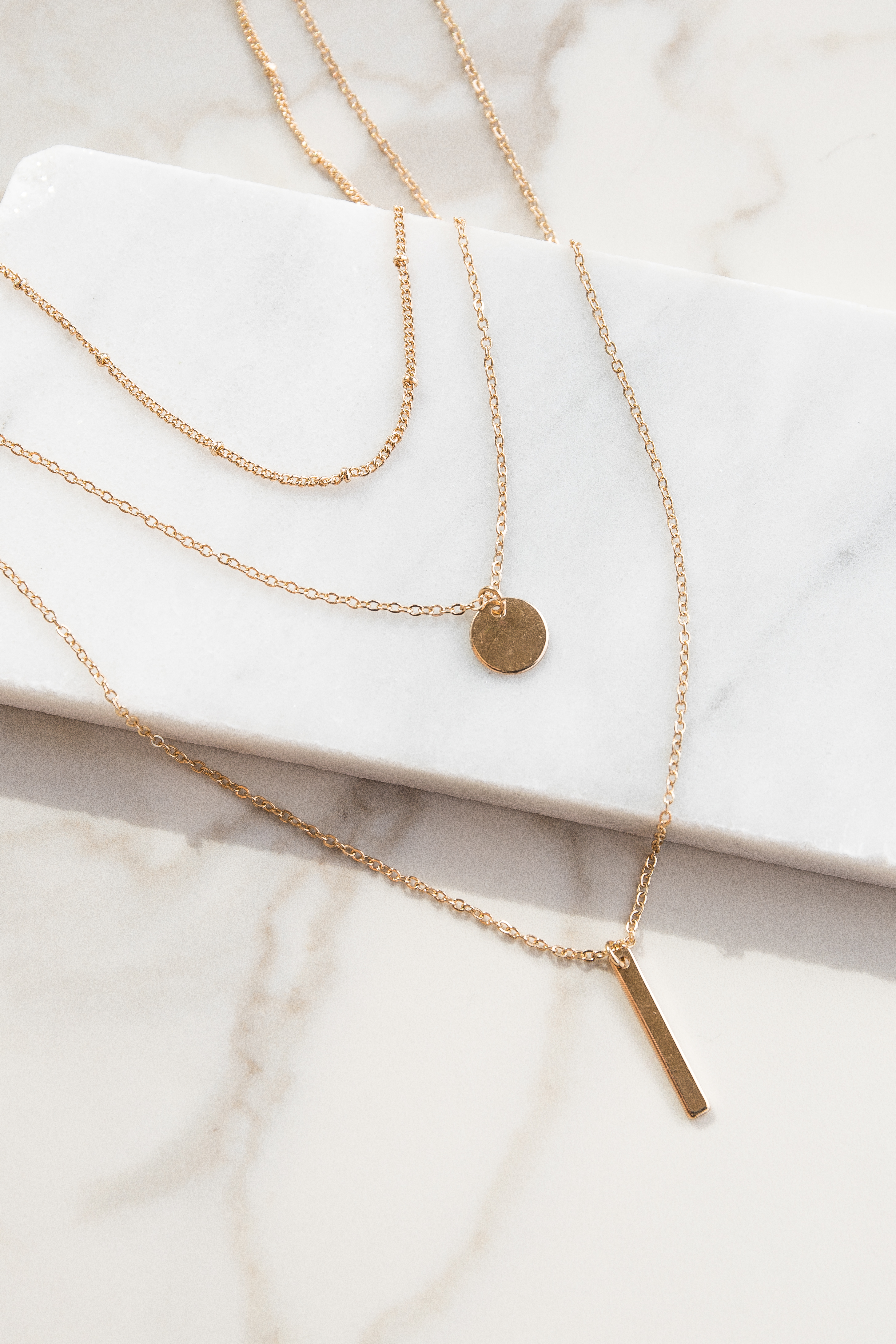 Gold Layered Necklace with Coin and Bar Pendants