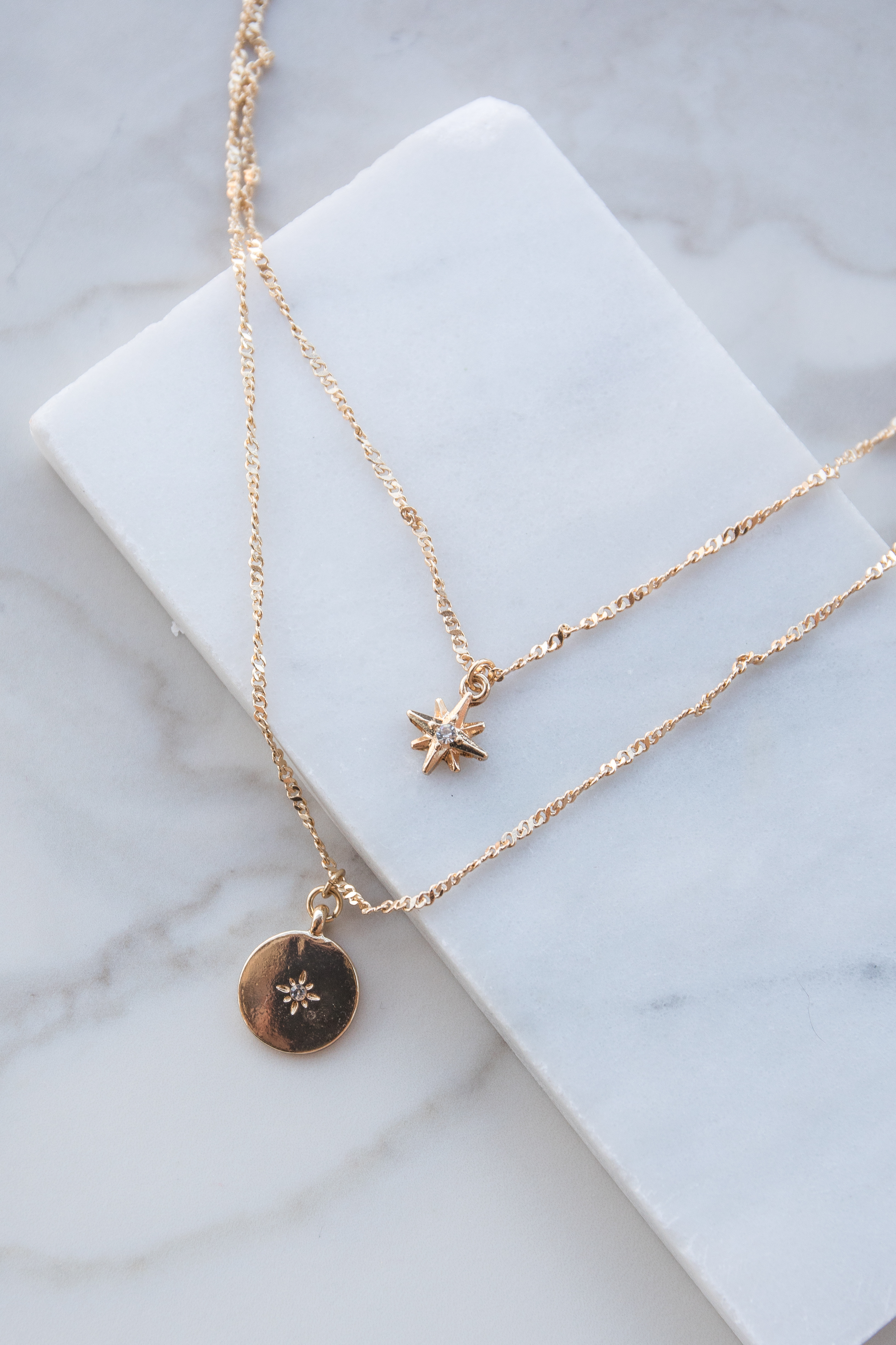 Gold Layered Necklace with Star and Coin Jeweled Pendants
