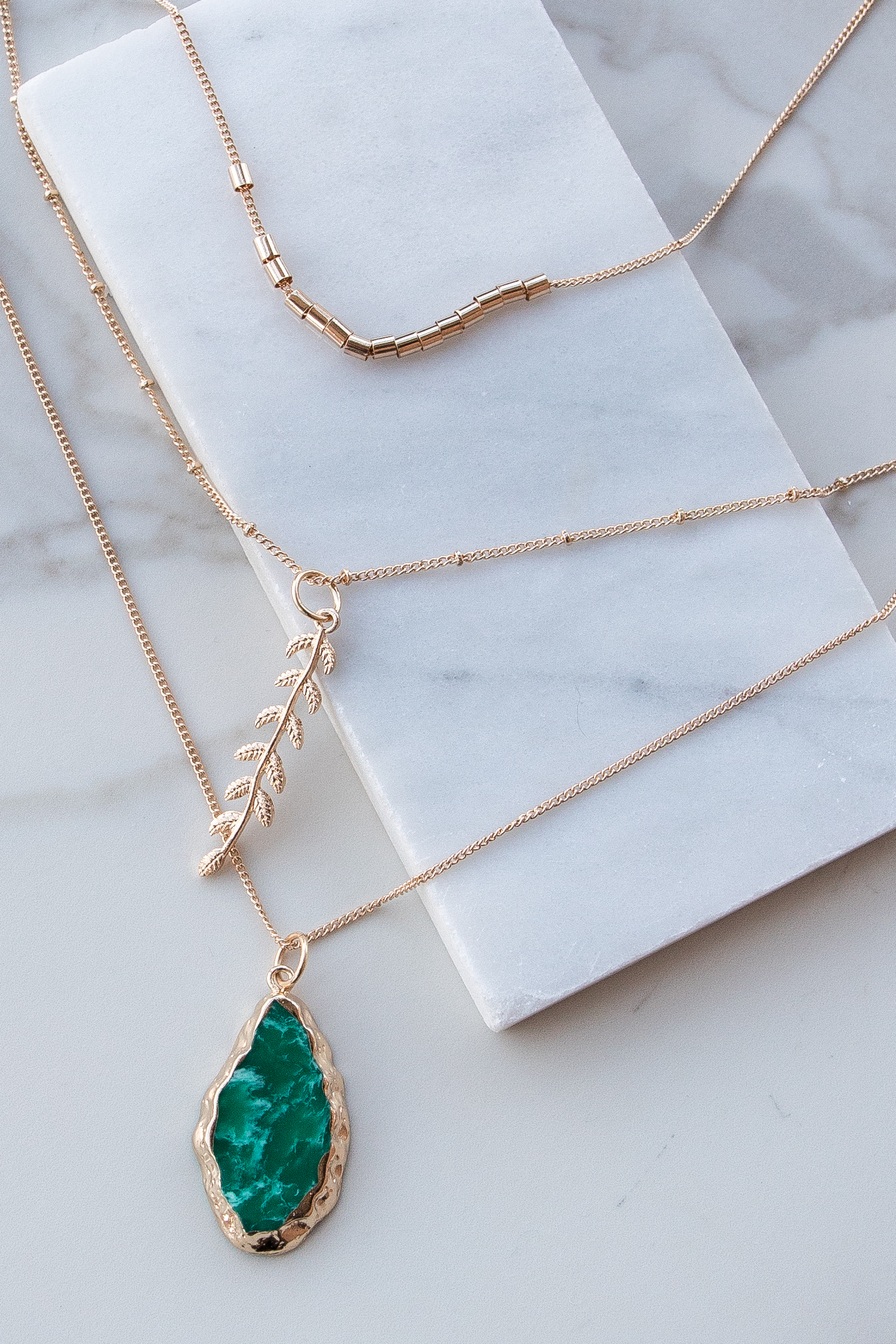 Gold Layered Necklace with Leaf and Turquoise Stone Pendant