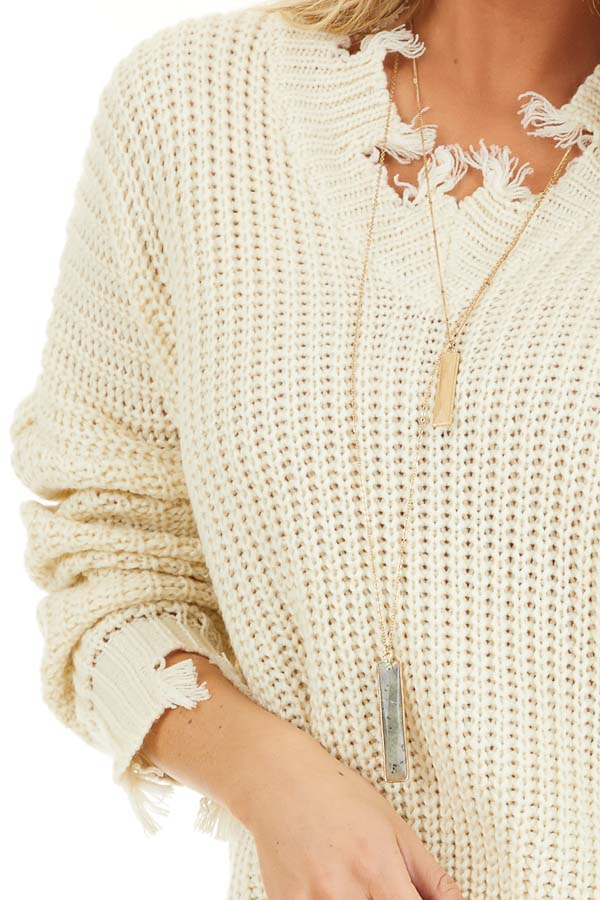 Ivory Long Sleeve Knit Sweater Top with Fringe Detail detail
