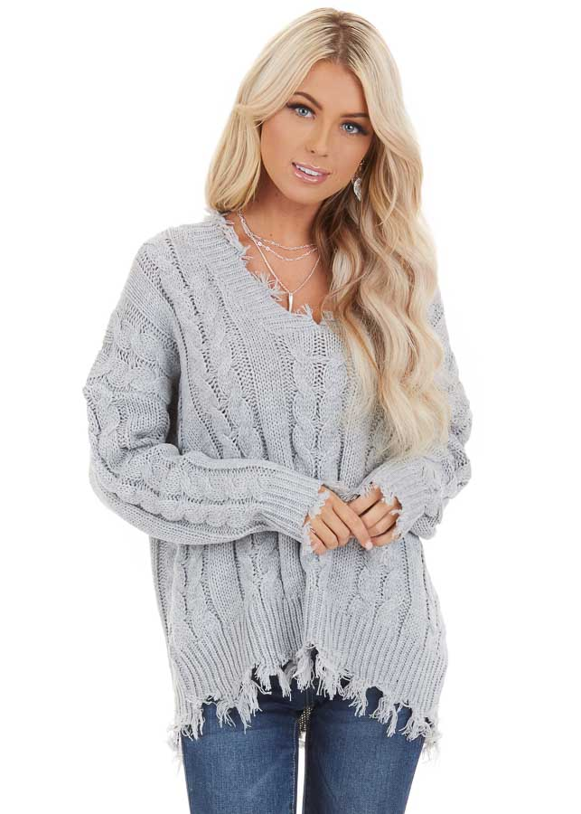 Silver Cable Knit V Neck Sweater with Frayed Hems front close up