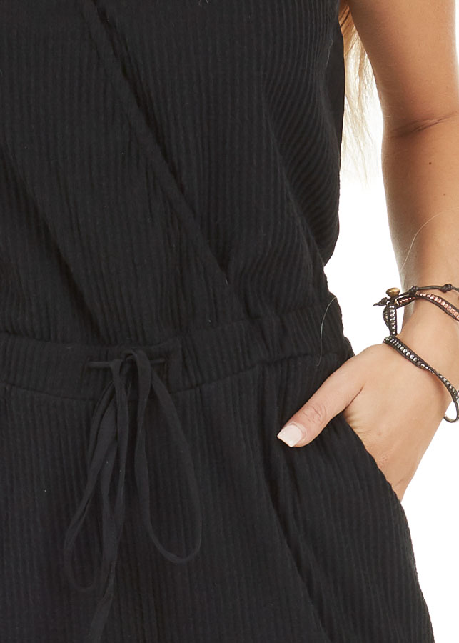 Black Sleeveless Jumpsuit with Cinch Waist and Pockets detail
