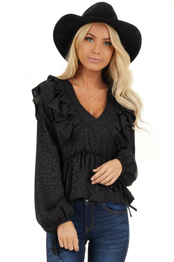 Black Animal Print Silky Peplum Top with Ruffle Details front close up