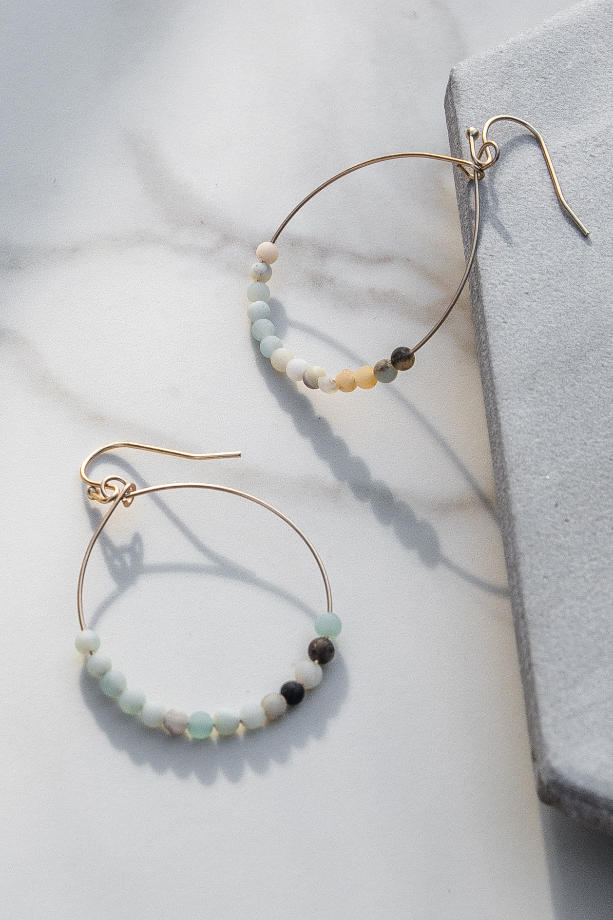 Gold Hoop Earrings with Mint and Amber Beaded Details
