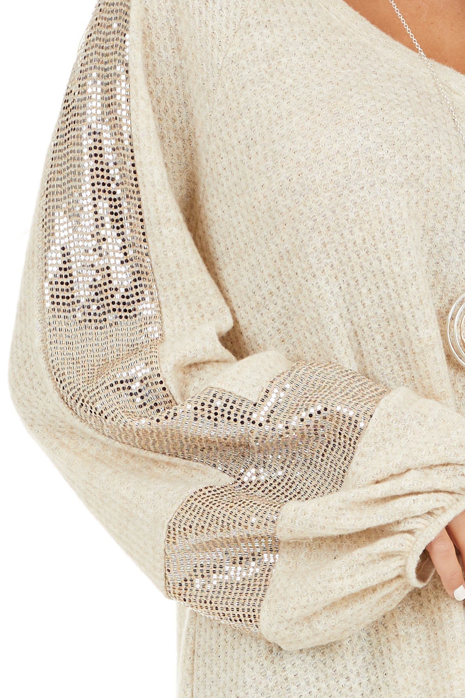 Ivory Waffle Knit Top with Sequined Bubble Sleeves detail