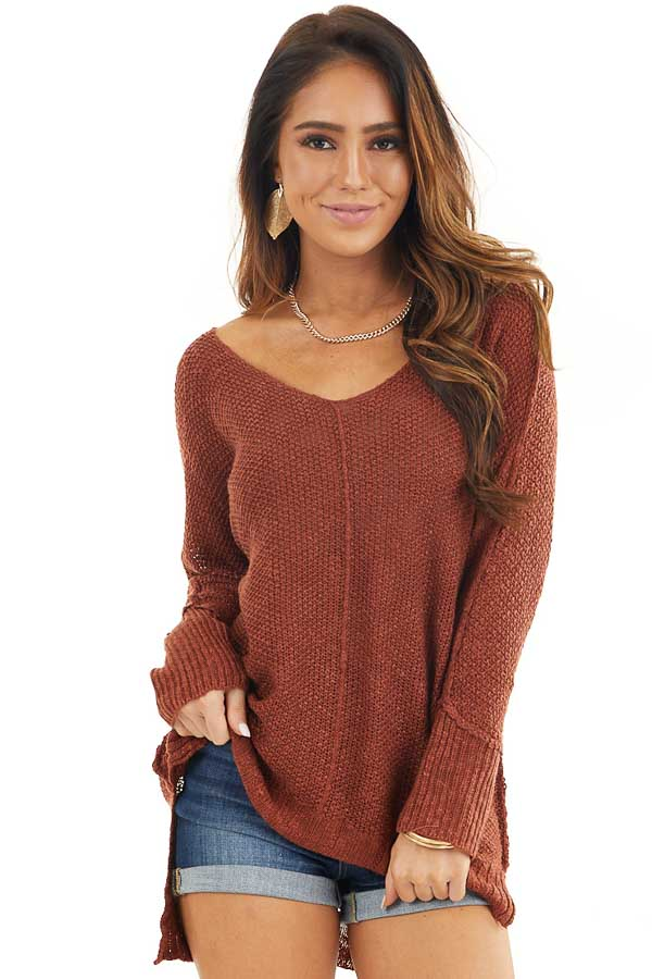 Rust Long Sleeve Knit Top with Side Slits and Exposed Seam front close up