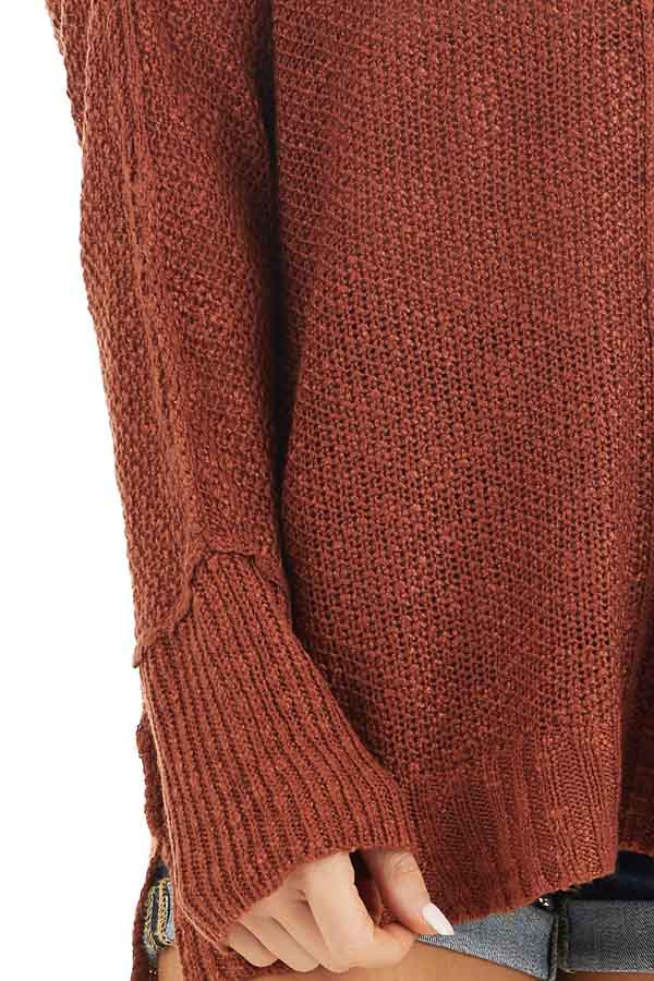 Rust Long Sleeve Knit Top with Side Slits and Exposed Seam detail