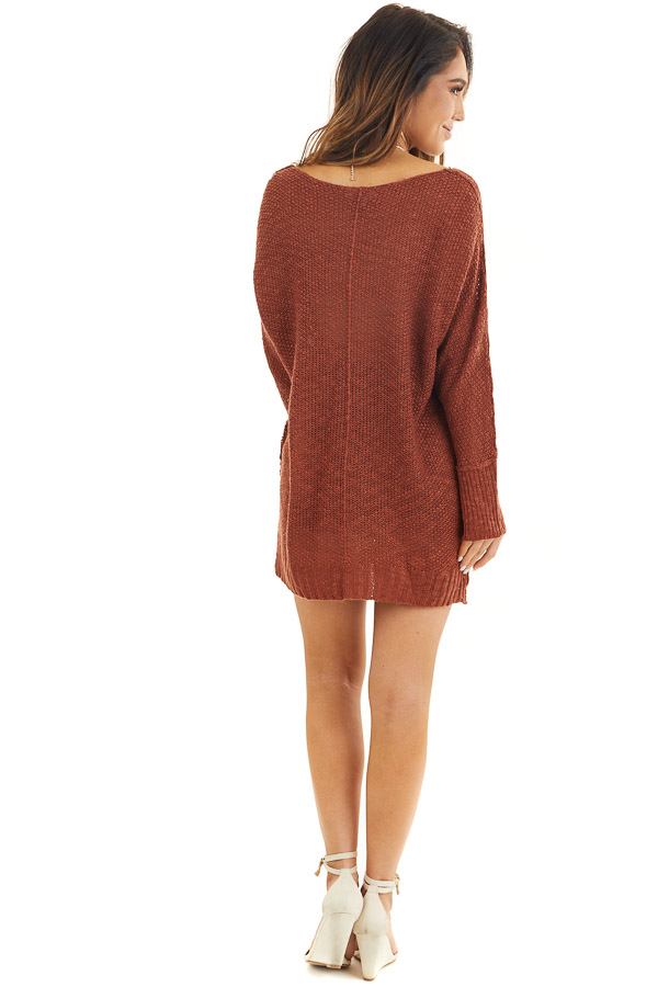 Rust Long Sleeve Knit Top with Side Slits and Exposed Seam back full body