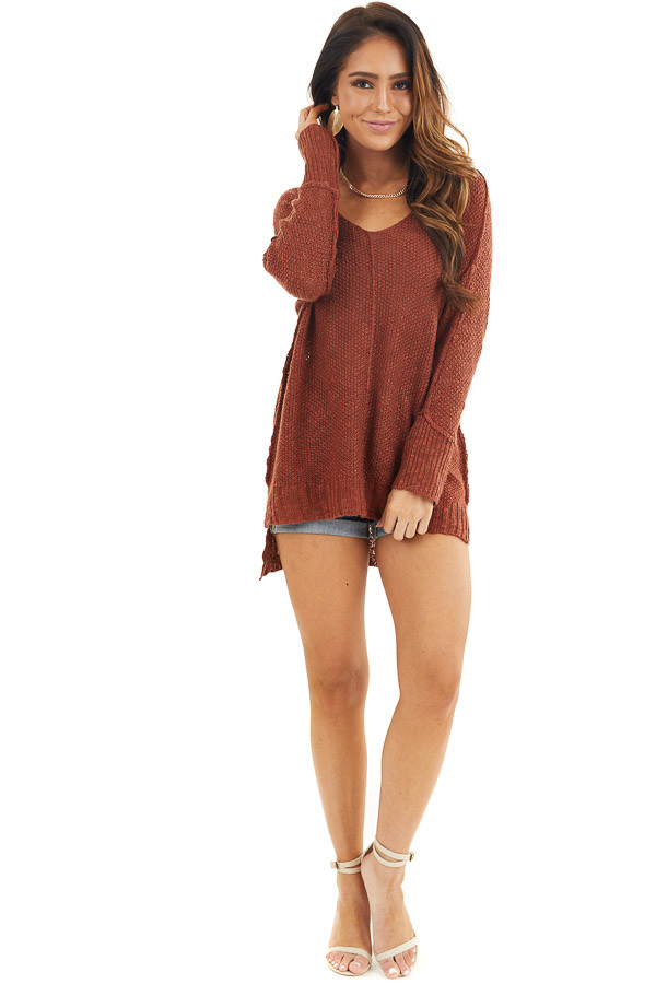 Rust Long Sleeve Knit Top with Side Slits and Exposed Seam front full body