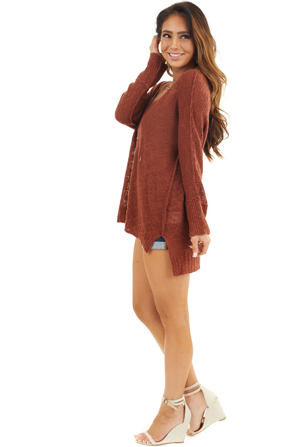 Rust Long Sleeve Knit Top with Side Slits and Exposed Seam side full body
