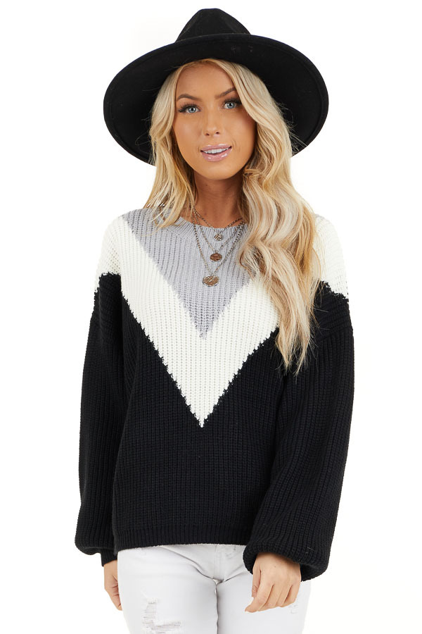Black Knit Sweater with V Shaped Color Block Detail front close up