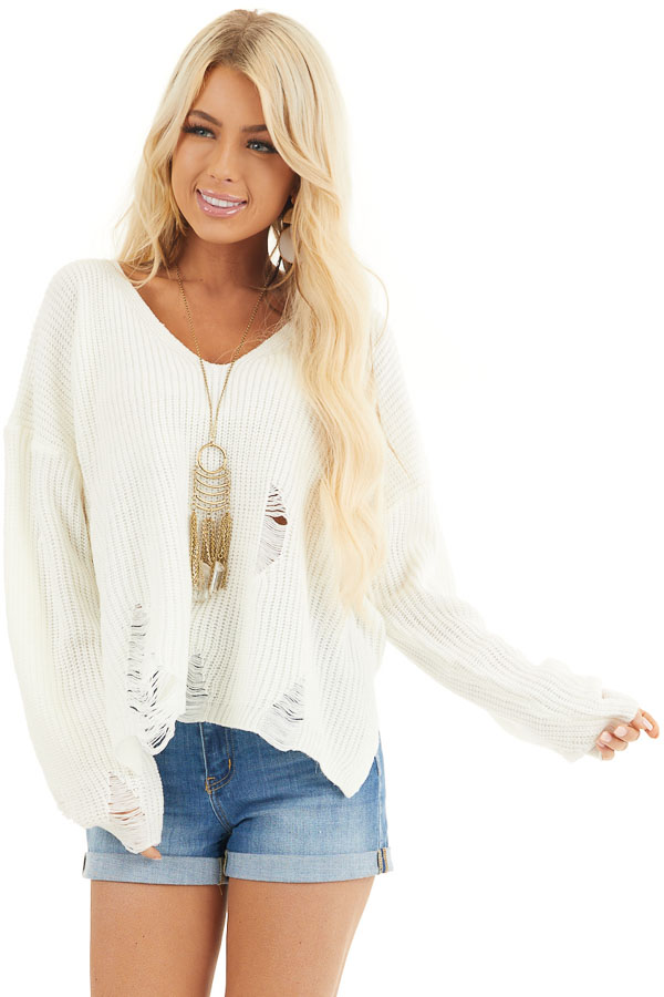 Ivory Long Sleeve Oversized Sweater with Distressed Details front close up