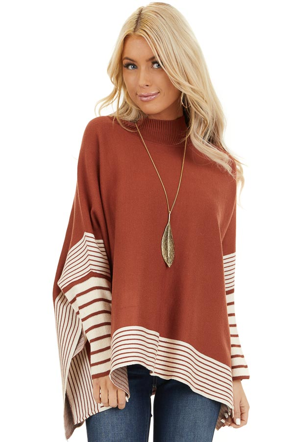 Rust Long Sleeve Mock Neck Poncho Style Top with Side Slits front close up