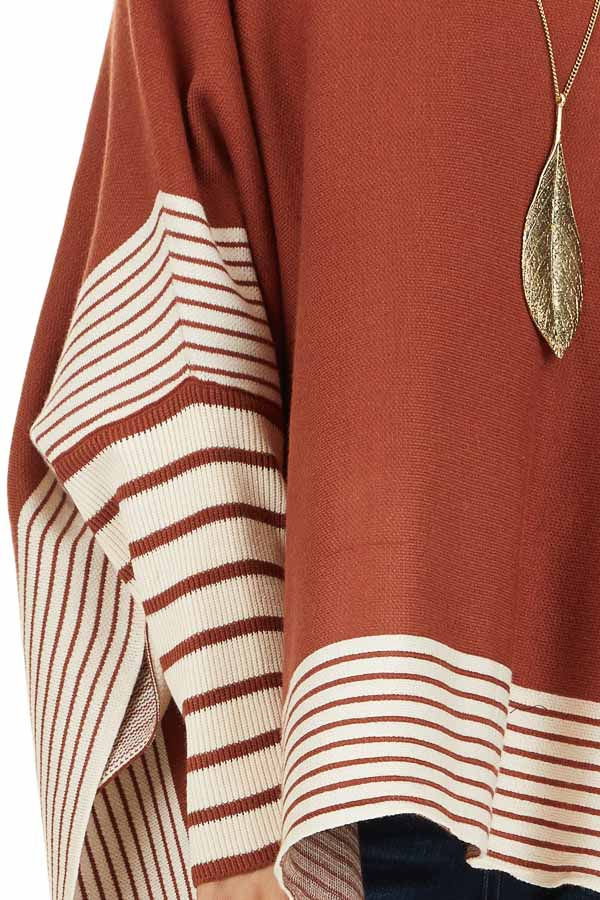 Rust Long Sleeve Mock Neck Poncho Style Top with Side Slits detail