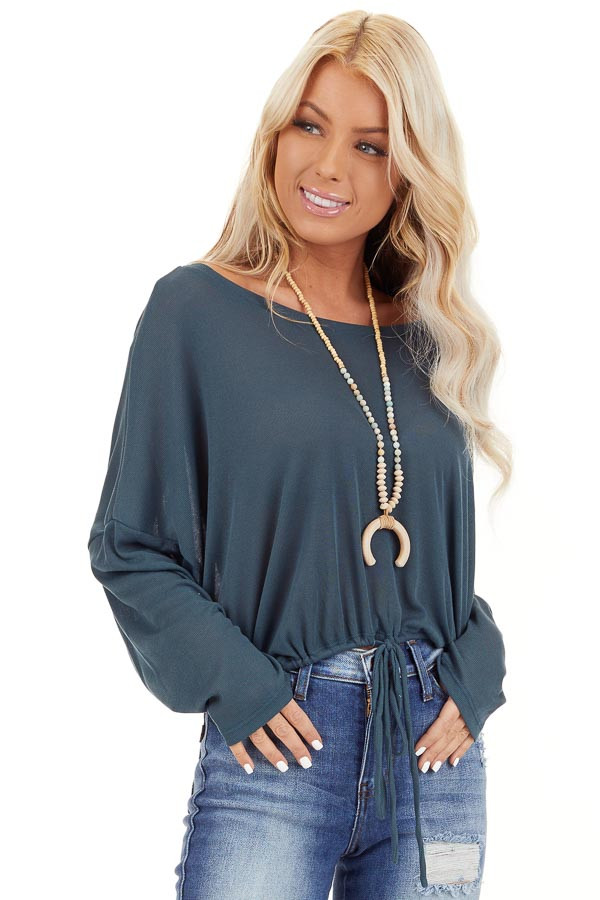 Teal Long Sleeve Top with Adjustable Drawstring Hemline front close up