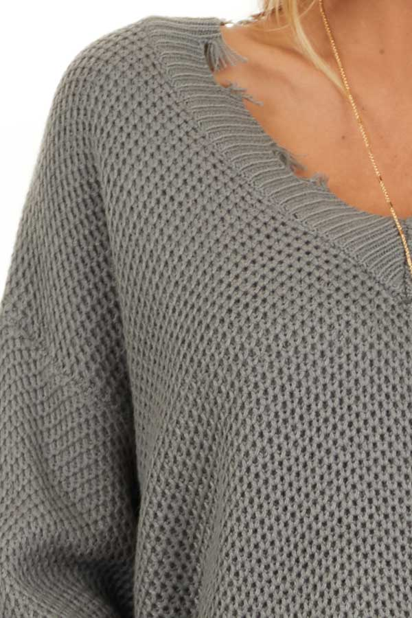 Stormy Grey Distressed Knit Sweater with V Neckline detail