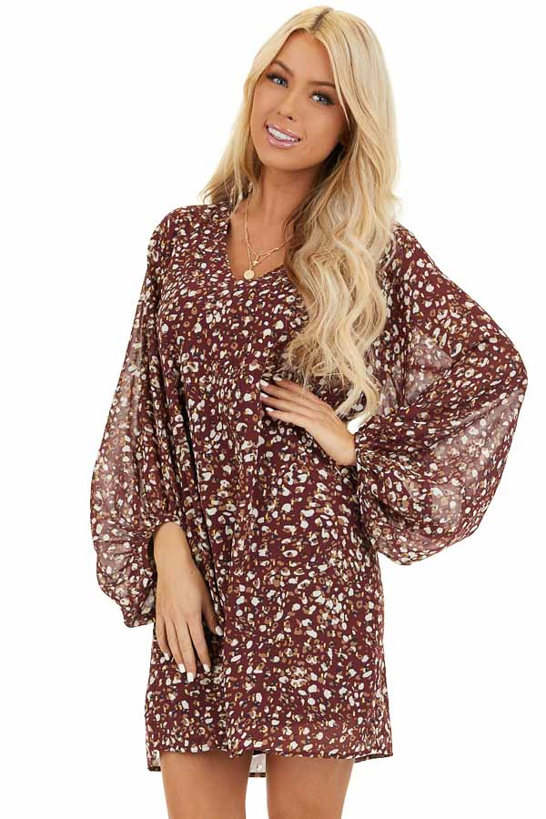 Wine Printed Long Sleeve Mini Dress with V Neckline front close up