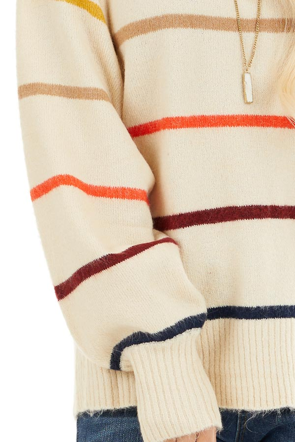 Cream Long Sleeve Sweater Top with Multi Color Stripes detail