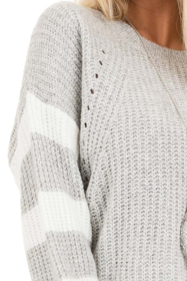 Grey Cable Knit Pullover Sweater with Striped Long Sleeves detail