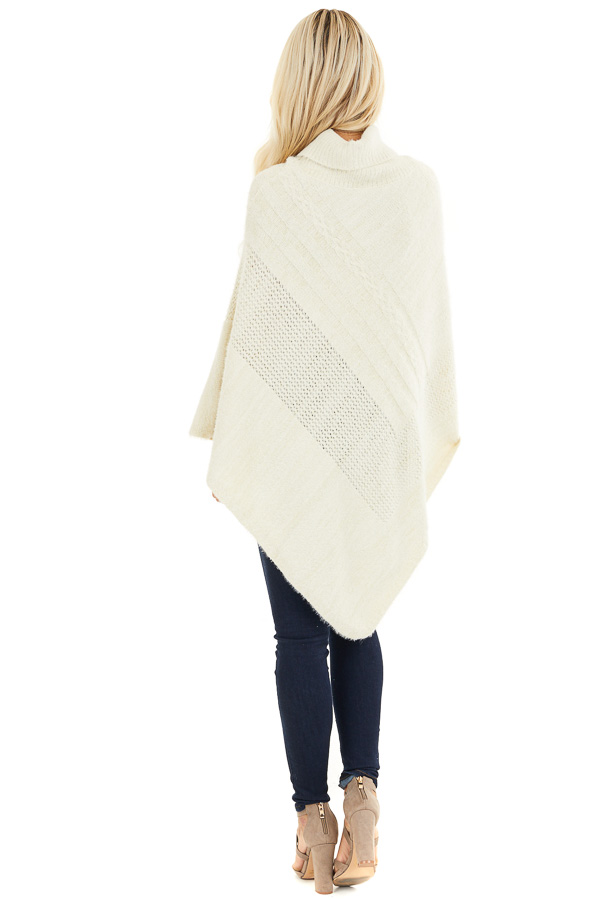 Cream Cable Knit Poncho with Turtleneck Detail back full body