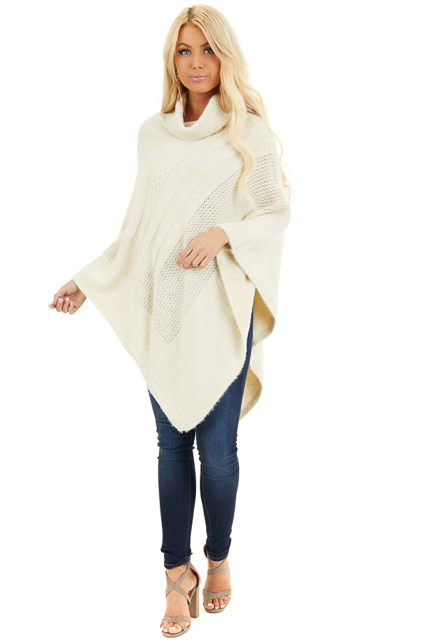 Cream Cable Knit Poncho with Turtleneck Detail front full body