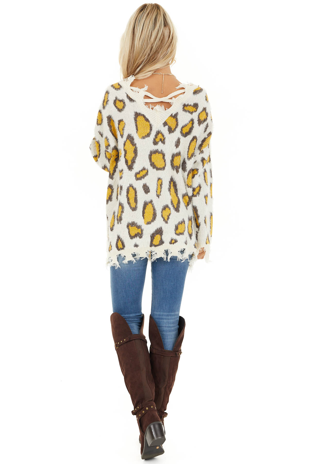 Ivory and Mustard Animal Print Sweater with Frayed Details back full body