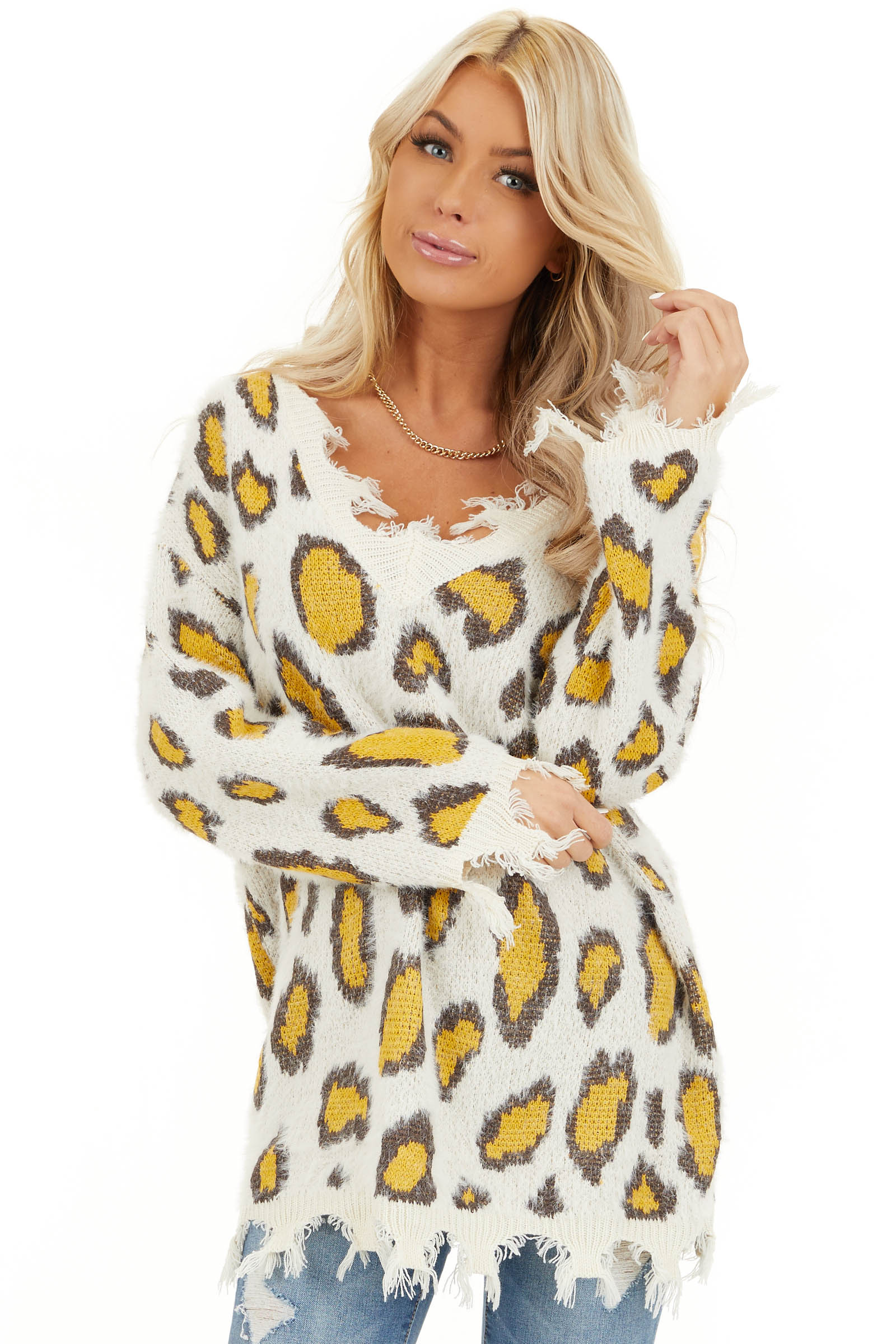Ivory and Mustard Animal Print Sweater with Frayed Details front close up
