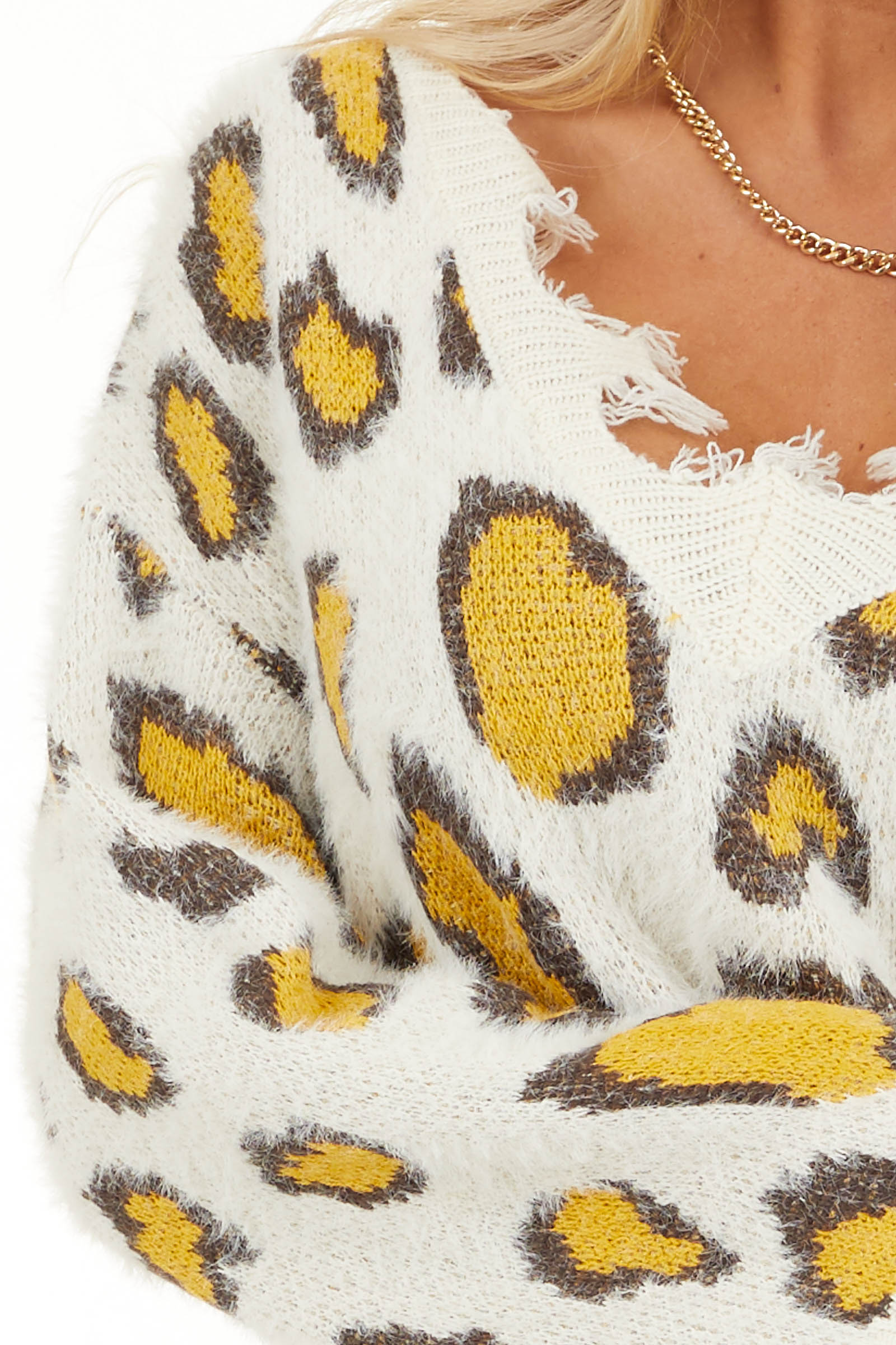 Ivory and Mustard Animal Print Sweater with Frayed Details detail