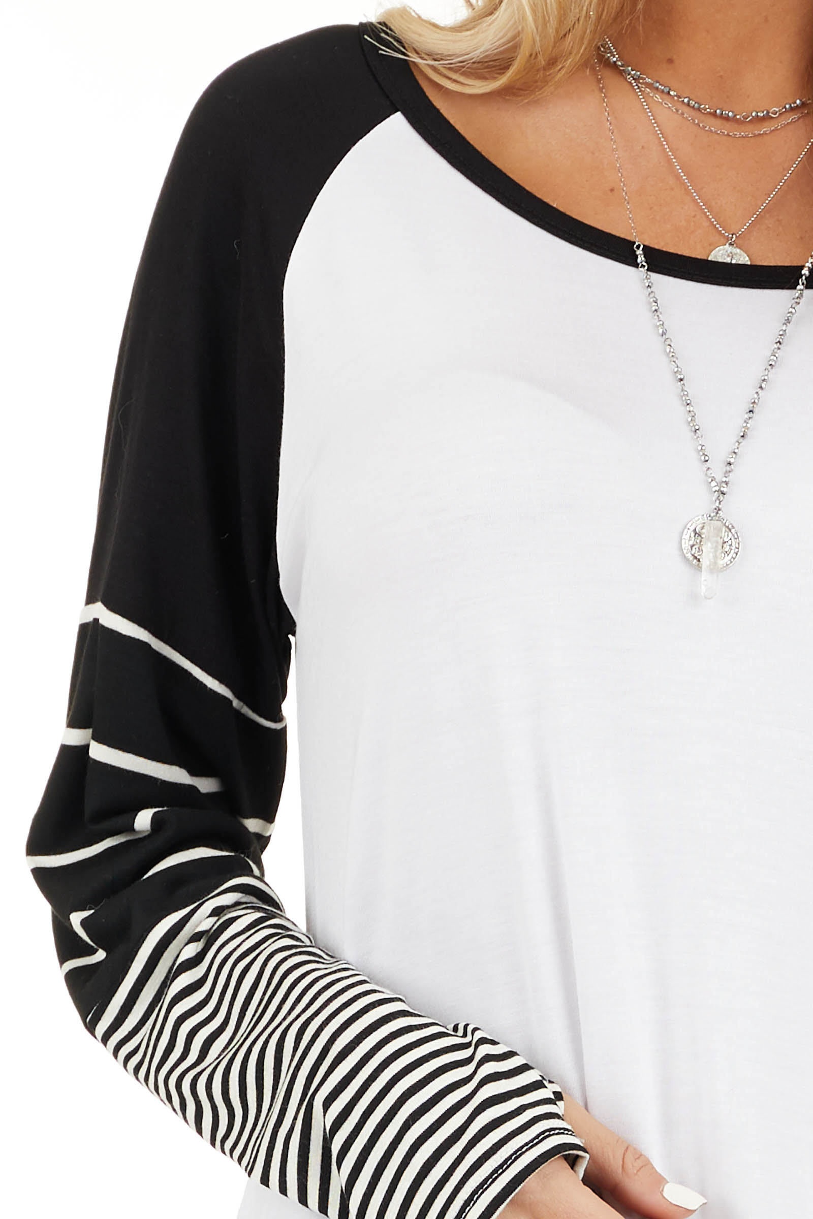 Black and White Knit Top with Long Striped Sleeves detail