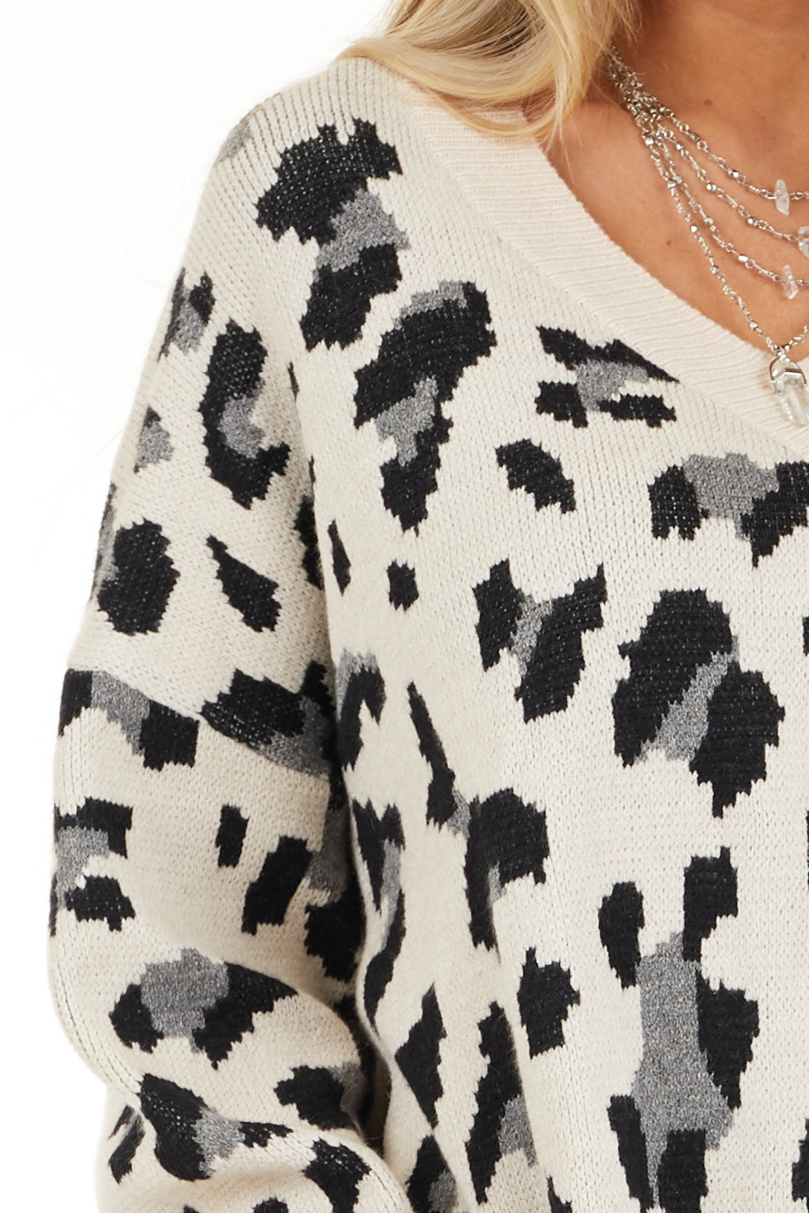 Champagne and Black Animal Print Sweater with V Neckline detail