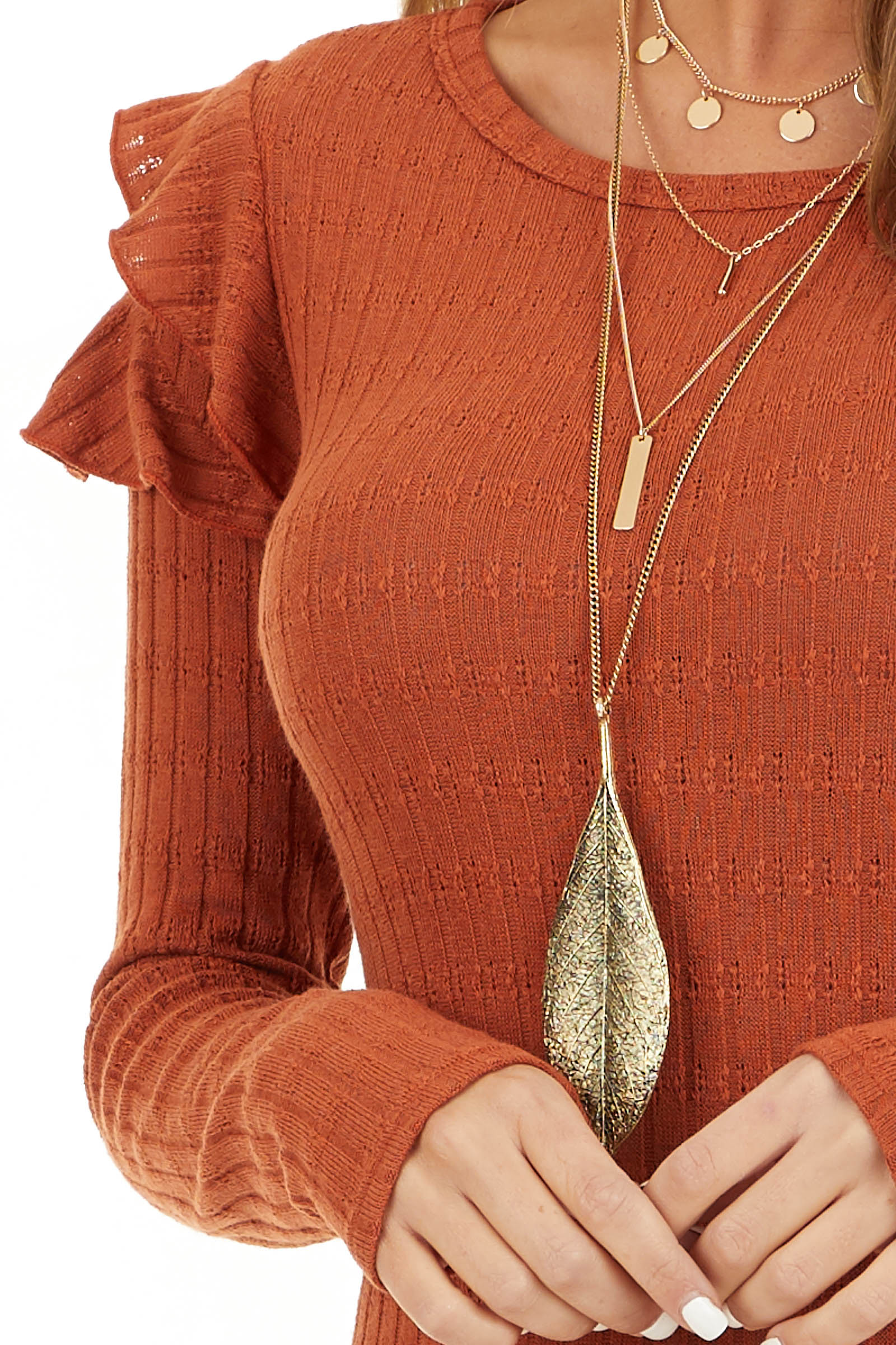 Rust Textured Knit Top with Long Sleeves and Ruffle Details detail