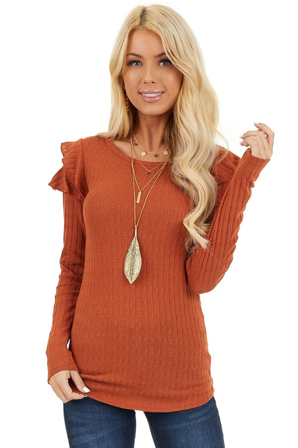 Rust Textured Knit Top with Long Sleeves and Ruffle Details front close up