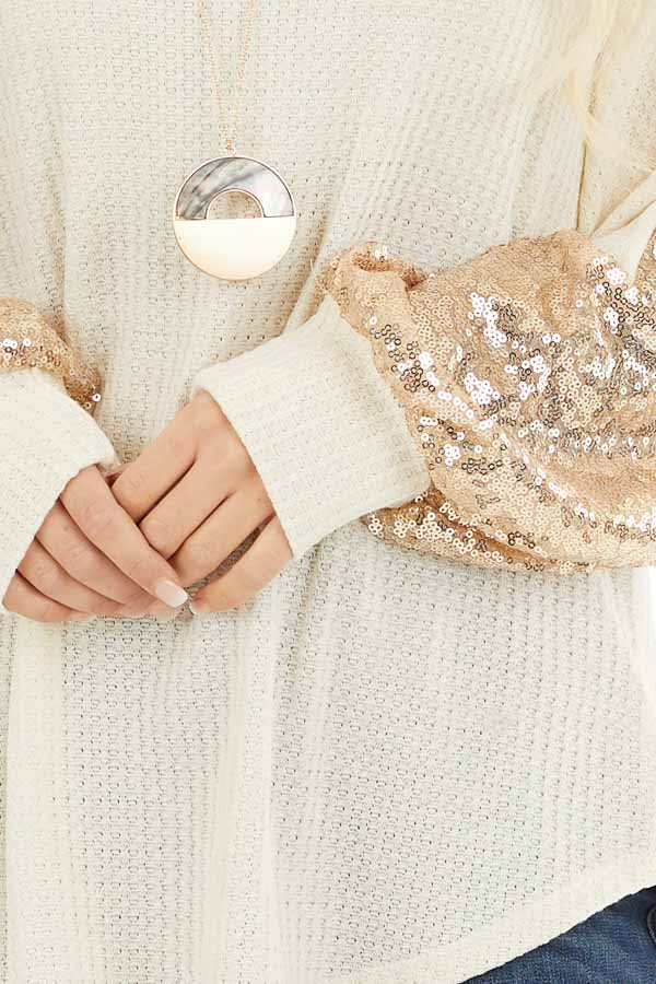 Cream Waffle Knit Long Sleeve Top with Gold Sequin Sleeves detail