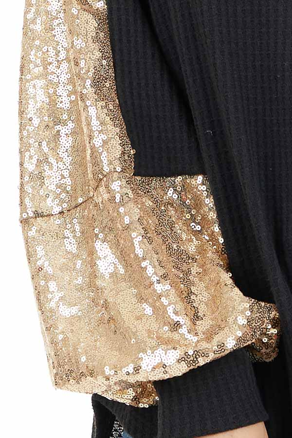 Black Waffle Knit Long Sleeve Top with Gold Sequin Sleeves detail
