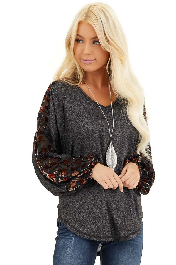 Heathered Black Knit Top with Floral Print Contrast Sleeves front close up