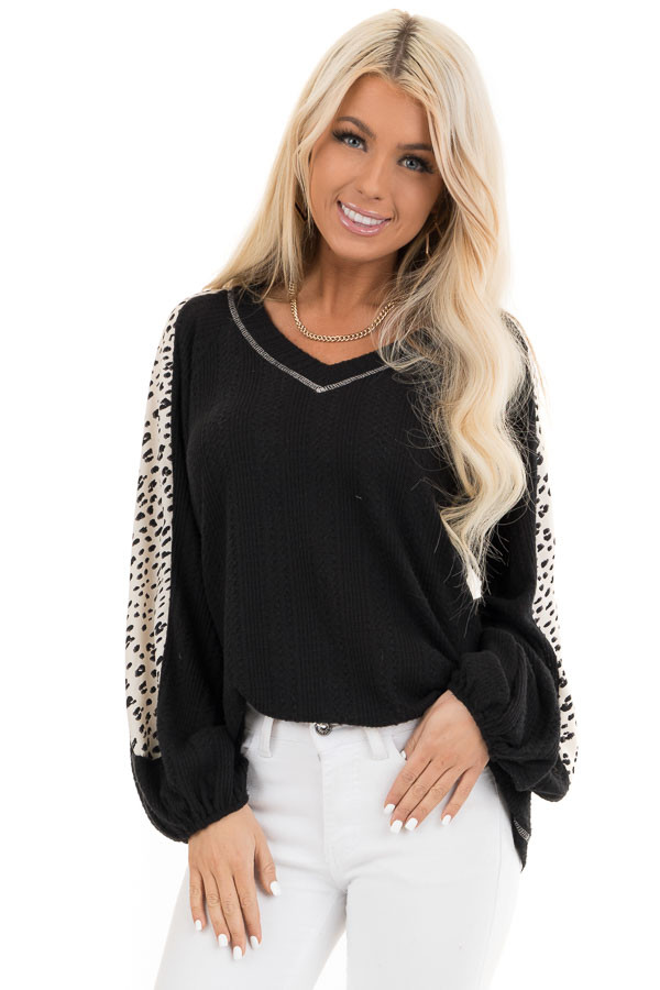 Black Waffle Knit Top with V Neck and Contrast Sleeves front close up