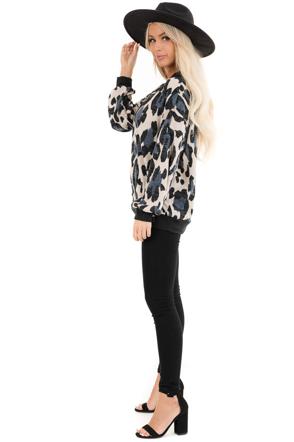 Ivory and Blue Leopard Print Knit Top with Contrast Neckline side full body