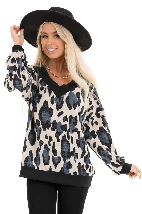 Ivory and Blue Leopard Print Knit Top with Contrast Neckline front close up