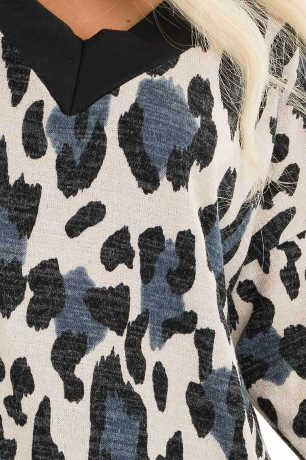 Ivory and Blue Leopard Print Knit Top with Contrast Neckline detail