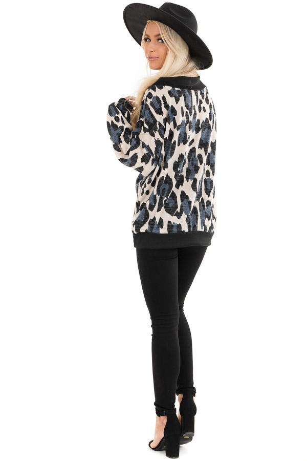 Ivory and Blue Leopard Print Knit Top with Contrast Neckline back full body