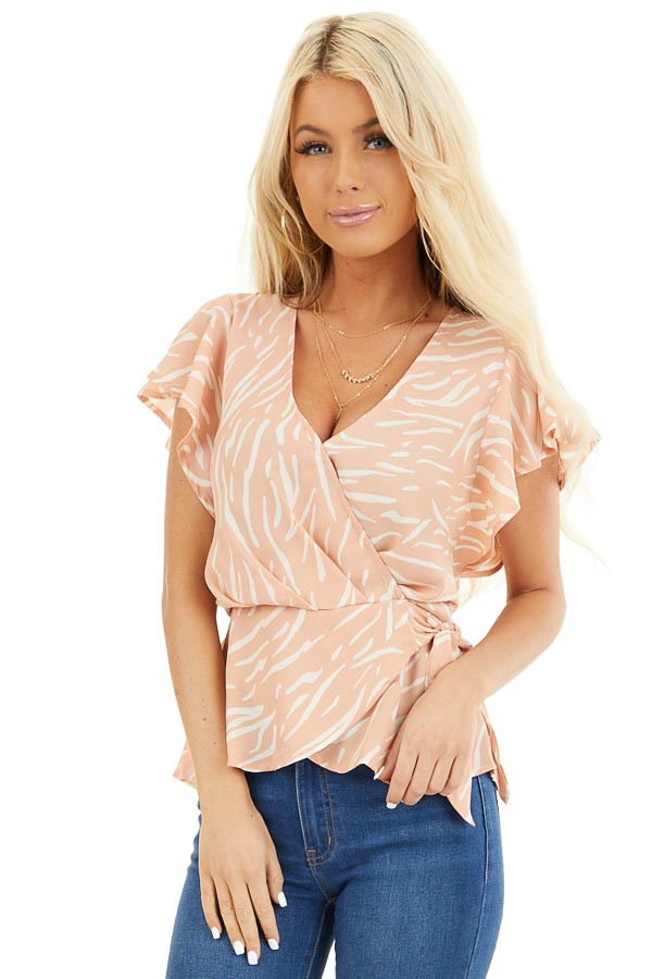 Peach and Ivory Printed Surplice Blouse with Side Tie Detail front close up