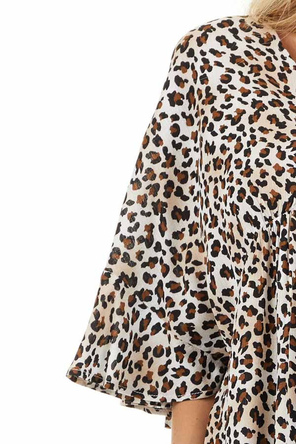 Cream Leopard Print V Neck Blouse with Batwing Sleeves detail